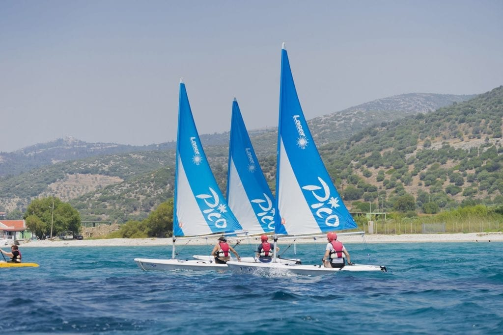 Three Pico sailing boats racing around the bay whilst on holiday in Samos