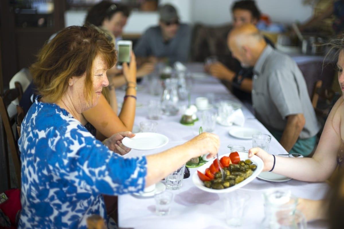 Guests enjoying freshly prepared Greek food in Vourliotes, Samos