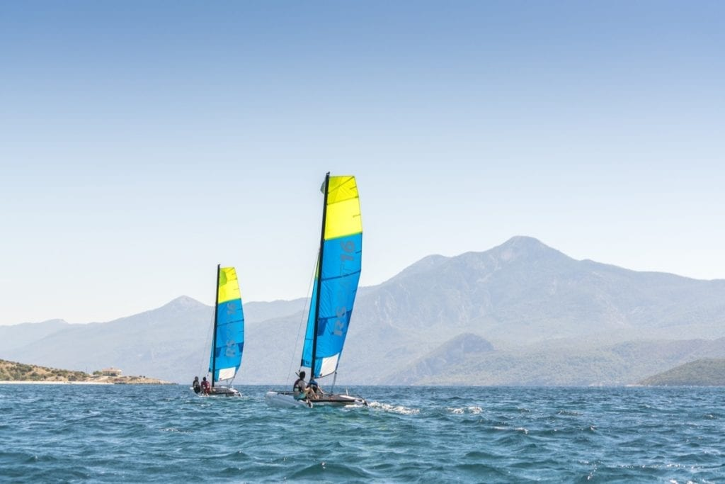 Sailing catamarans in Mykali Bay, Samos, Greece thanks to Richmond Holidays RYA Waterfront