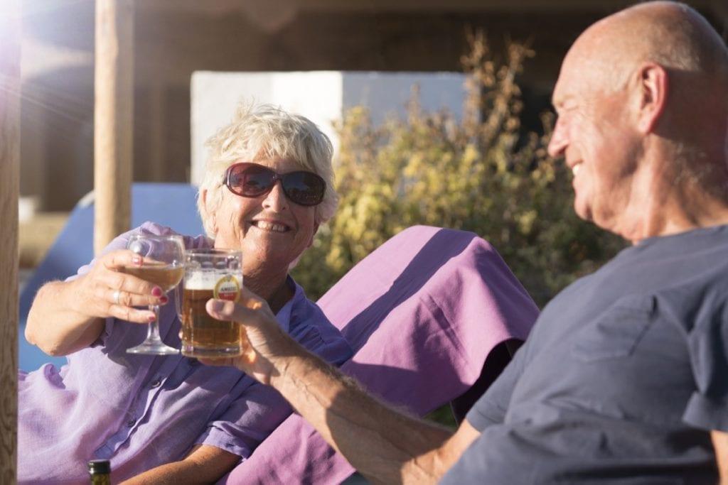 A couple enjoying their summer holiday at the Zefiros Beach Hotel, Samos, Greece
