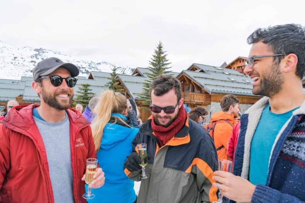 Guests enjoying a glass of champagne during their ski holiday