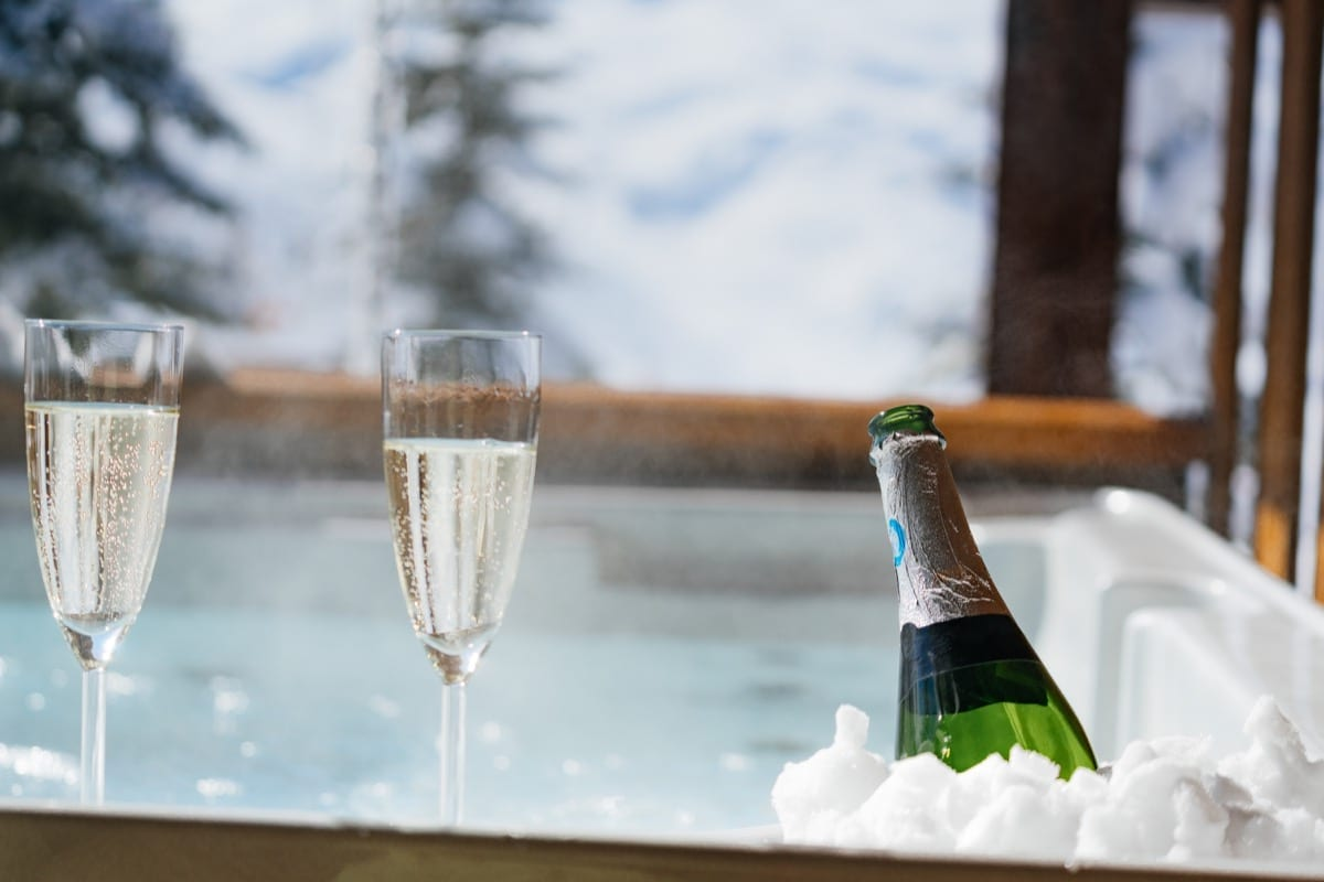 Champagne in the hot tub on a Richmond ski holiday