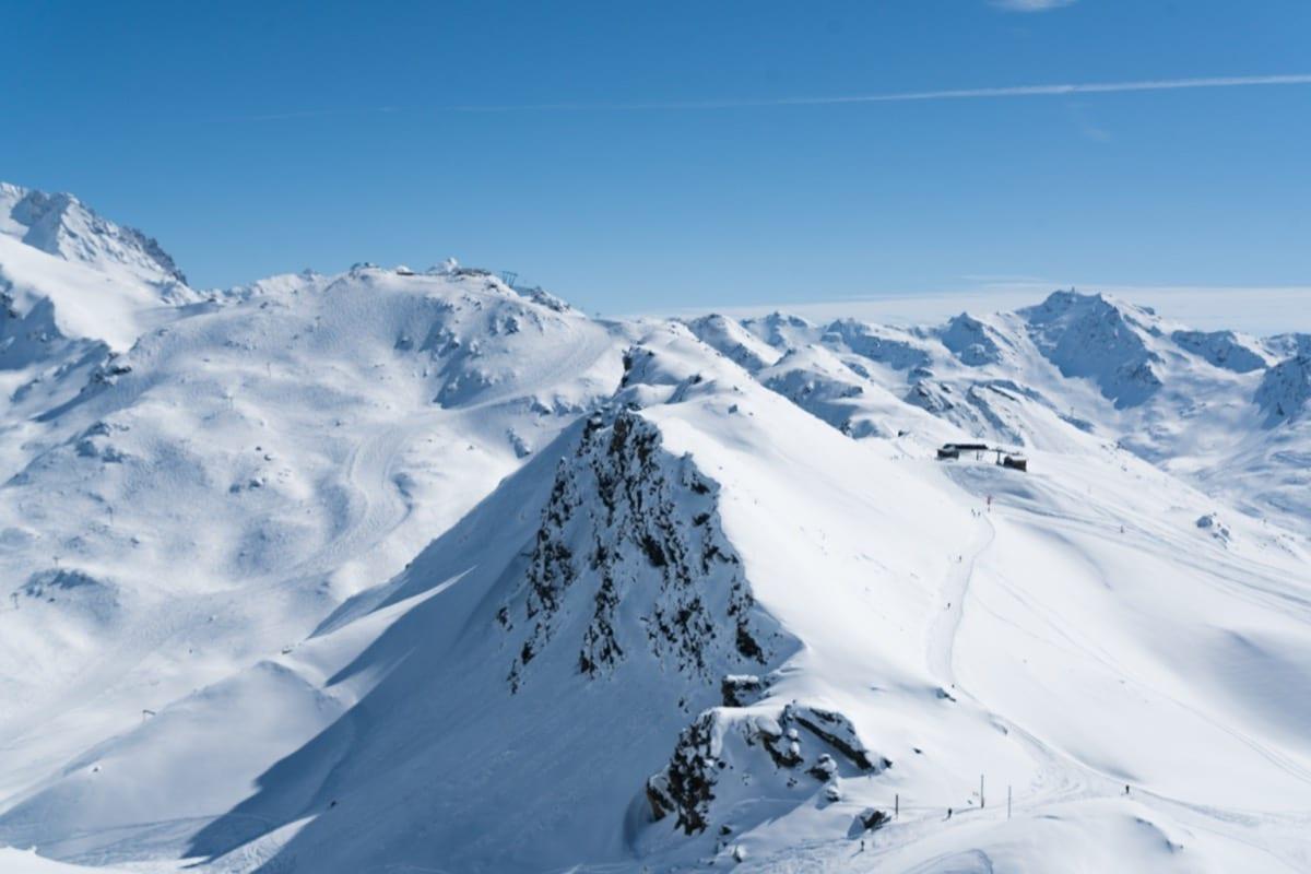 The mountain peaks under blue skies in France