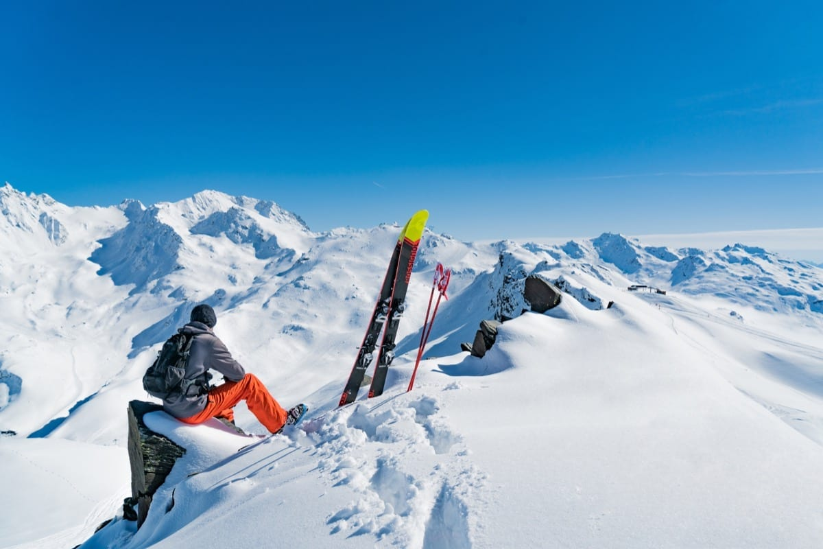 Taking a break from skiing to look over the snow covered mountain peaks of the Three Valleys