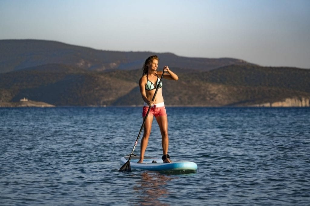 Stand up paddle boarding in Samos, Greece on a summer's evening