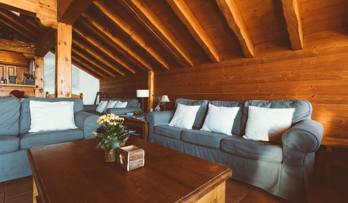 Comfy sofas around a coffee table in the holiday destination Chalet des Neiges, Reberty, The Three Valleys Ski resort